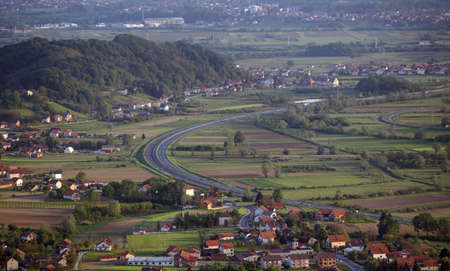 Motorway Zagreb - Maribor curves through the green Zagorje, Croatia, pictured from the air