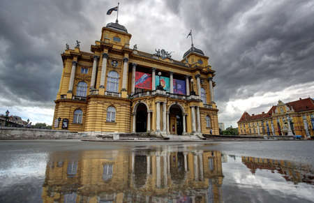 Croatian National Theatre reflection in water after spring shower