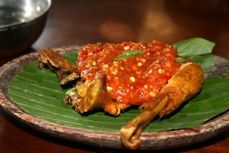 Smashed Fried Chicken Dish in Bali, Indonesia. photo