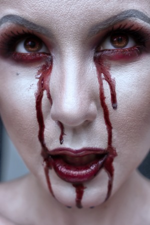 beautiful vampire: Beautiful vampire woman, close-up red lips, eyes in blood, grey skin. Halloween or horror theme.