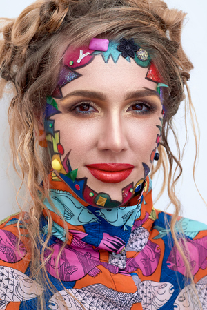 avant: Close up portrait of young beautiful woman, model,  clown. Bright creative fantasy makeup, geometric shapes, circles. Multicolored paint, red, blue, orange, yellow, pink. Pop art style, avant garde.