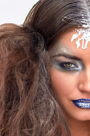 sexy woman nude: Beauty girl with blue lips, silver eyeshadow. Art makeup with glitters. Curly snowy hair. Young sexy model. Close up portrait. Stock Photo
