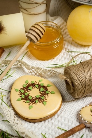 suger: easter gingerbread with suger petals, egg shaped honey-cake, kitchen celebration spring beige green grass design, food photography