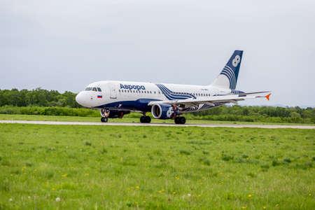 Russia, Vladivostok, 05262017. Passenger airplane Airbus A319 of Aurora just landed.