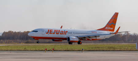 Russia, Vladivostok, 10/13/2017. Passenger jet aircraft Boeing 737-8AS of JeJu Air takes off. Aviation and transportation.