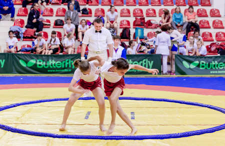 Russia, Vladivostok, 06/30/2018. Sumo competition among girls born in 2003-2004. Teenage tournament of martial arts and fighting sports. Editoriali