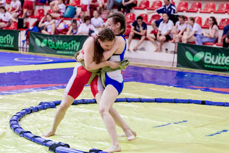 Russia, Vladivostok, 06/30/2018. Sumo competition among girls born in 2003-2004. Teenage tournament of martial arts and fighting sports.