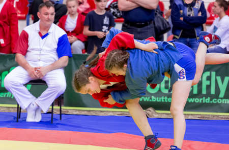 Russia, Vladivostok, 06/30/2018. Wrestling competition among girls born in 2003-2004. Teenage tournament of martial arts and fighting sports.
