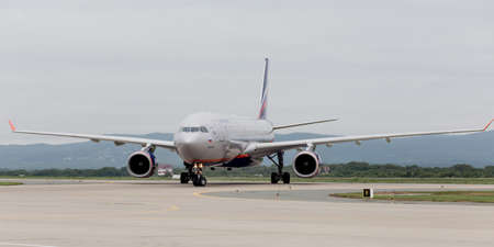 Russia, Vladivostok, 08102018. Modern passenger airplane Airbus A330 of Aeroflot Airlines on runway in cloudy day. Aviation and transportation.