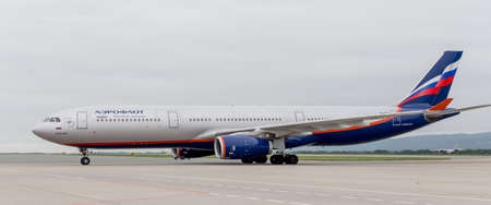 Russia, Vladivostok, 08102018. Modern passenger airplane Airbus A330 of Aeroflot Airlines is landing in cloudy day. Aviation and transportation. Editorial
