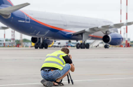 Russia, Vladivostok, 08102018. Photographer makes photo of Airbus A330 of Aeroflot Airlines on airfield. Plane spotting, hobby, aviation.