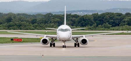Russia, Vladivostok, 08102018. Passenger airplane SSJ 100 (Sukhoi Superjet 100) of IrAero on airfield in cloudy day. Aviation and transportation.