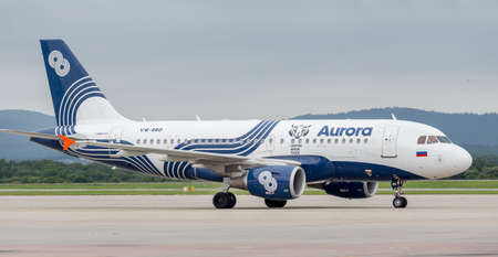 Russia, Vladivostok, 08102017. Modern passenger airplane Airbus A319 of Aurora Airlines on runway. Aviation and transportation.