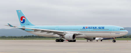 Russia, Vladivostok, 08102018. Passenger jet aircraft Airbus A330-300 of Korean Air (South Korea) on the airfield in cloudy day. Aviation and transportation.