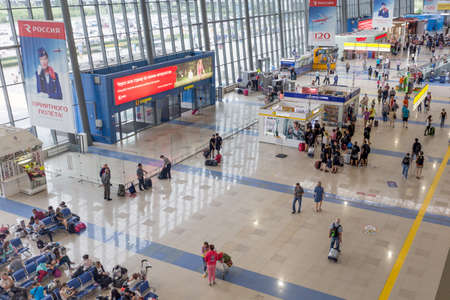 Russia, Vladivostok, 10082018. Interior view of Vladivostok International Airport. Many passengers waiting for boarding, cafe and stores. Editorial