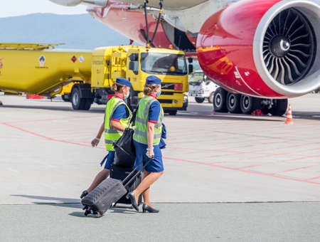 Russia, Vladivostok, 08/17/2020. Crew of airplane in official uniform of Rossiya Airlines goes to board of plane Boeing 777 of Rossiya Airlines. Crew of plane. Aviation and transportation.