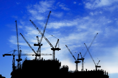 silhouetted: construction site silhouetted on daytime Stock Photo
