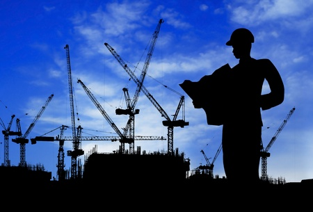 silhouette of a man working on construction site in day time photo