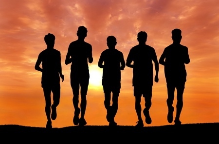 silhouette of group of man running at sunset photo