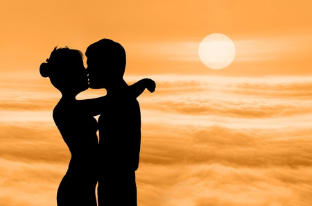 silhouette of kissing lovers in the morning photo