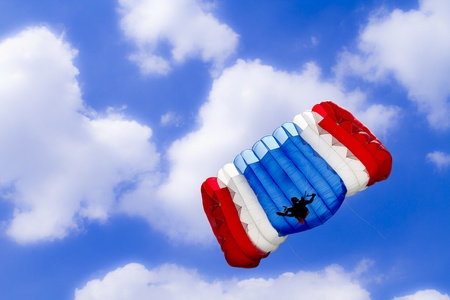 parachute on beautiful blue sky photo