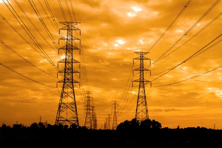 pylon: electric pylon at sunrise Stock Photo