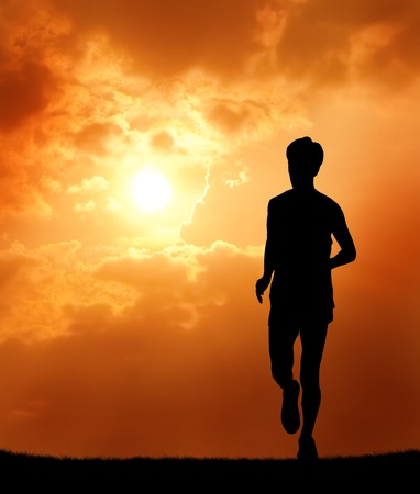 profile: a man running at sunset silhouetted
