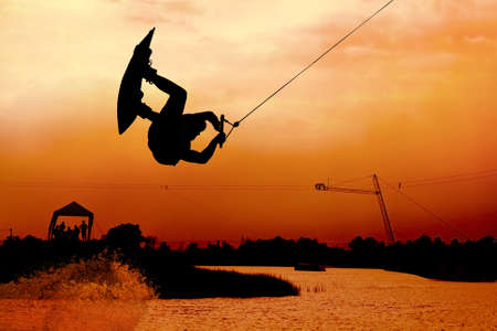 wakeboarding action on beautiful sky photo