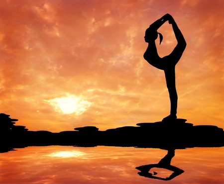 silhouetted of a beautiful woman Yoga in the morning photo