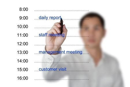 emploi du temps: la main d'affaires rendez-vous calendrier �crit sur un tableau blanc Banque d'images