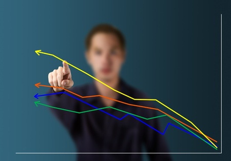 business trends: male hand pointing at  highest upward trend graph