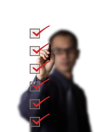 business man checking on checklist boxes Stock Photo - 13193823