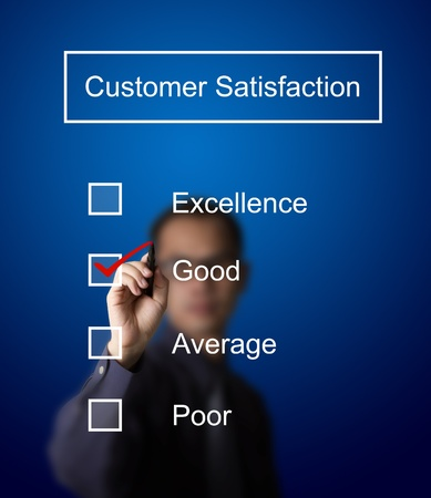 business man checking  good on customer satisfaction survey form Stock Photo - 13193854