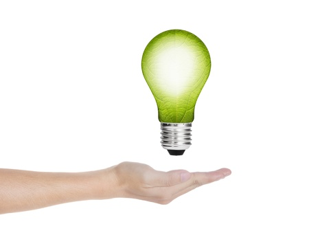eco green energy saving in the future concept, hand holding  leaf in electric light bulb photo