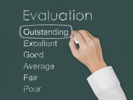 teacher hand evaluate outstanding on chalkboard Stock Photo - 13194112