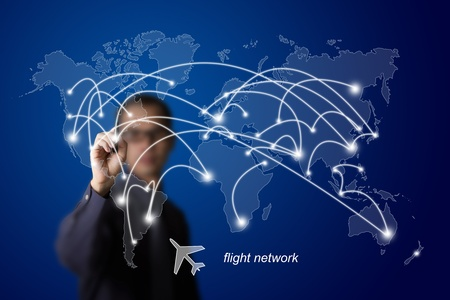 businessman drawing plane transportation route network photo