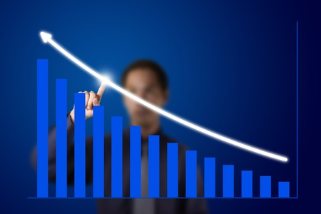 business man pointing at upward trend graph Stock Photo - 13193869