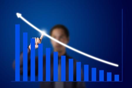 upward graph: business man pointing at upward trend graph