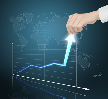 market trends: hand pulling financial business graph to high growth rate