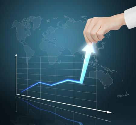 ascending: mano tirando gr�fico de negocio financiero a alta tasa de crecimiento
