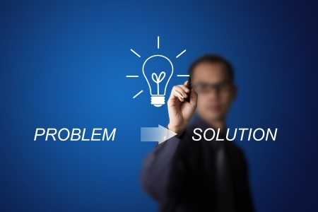 business man drawing idea can change problem to solution Stock Photo
