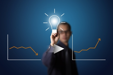 good idea can change downward to upward business writing by business man Stock Photo - 13193872