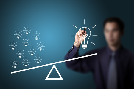 uneven: business man drawing many small idea have more weight than one big idea Stock Photo