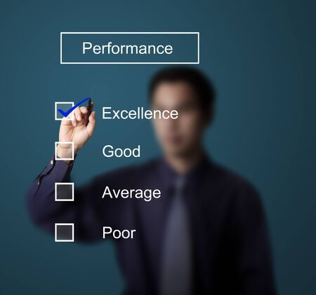 evaluate: business man checking  excellence on performance evaluation form Stock Photo
