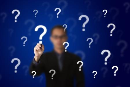 bewilder: business man writing question mark Stock Photo