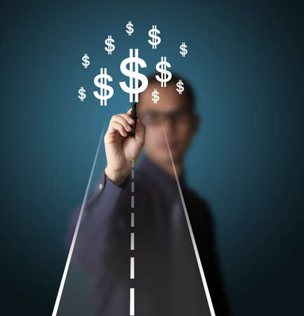business man drawing road to money or wealth photo