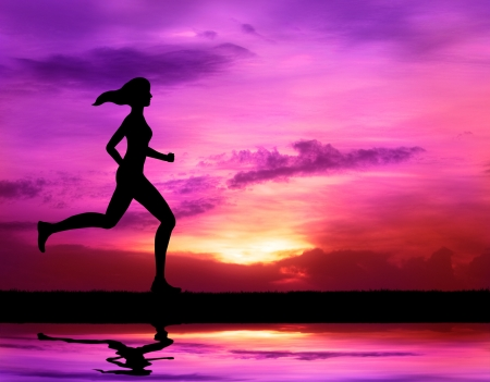 healthy woman running at sunrise silhouetted photo