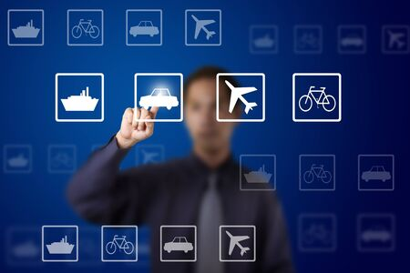 business man select transportation route by pushing a car button on touch screen photo