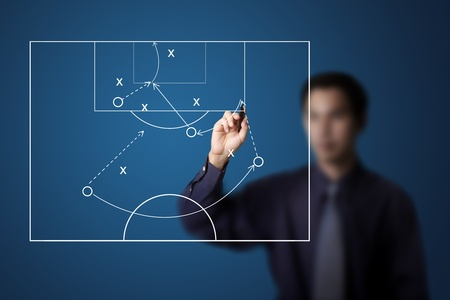 coach: soccer coach drawing strategy plan Stock Photo