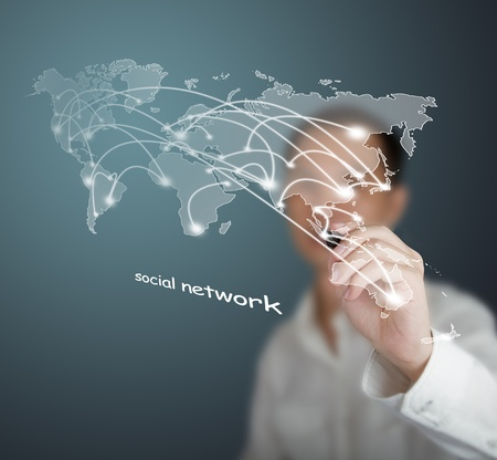 social web sites: business man drawing social network or business connection with world map on white board